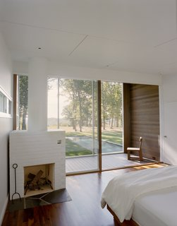 A wood-burning fireplace adorns the master bedroom.  A private screened-in porch provides a quiet oasis in which to enjoy the natural setting.