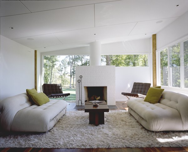 Although the spaces have been updated, the home's midcentury style shines through.
