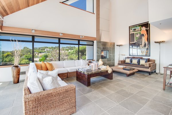 Large windows offer expansive views of the Malibu hillside.