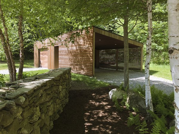 A wood-wrapped carport completes the property. The cottage is located near two additional homes Breuer completed for Stillman, which can be accessed by trails.