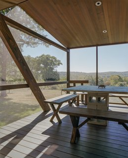 A cantilevered screen porch provides an ideal location for outdoor dining.
