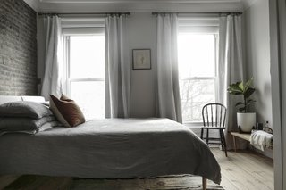 Large windows draw plentiful daylight into the master bedroom.
