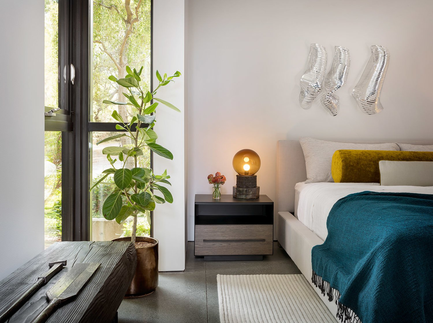 Bedroom, Bed, Bench, and Night Stands Rich colors, textiles, and playful artwork decorate the simple architectural palette.  Photo 15 of 20 in Geremia Design Imbues an Olson Kundig Retreat With Warm Tones and Modern Art from False Bay Home and Writer's Cabin
