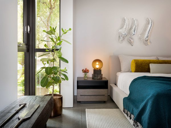 Rich colors, textiles, and playful artwork decorate the simple architectural palette.