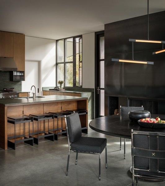 The Olson Kundig-designed kitchen features green soapstone countertops and oak veneer cabinets, with custom Olson Kundig hardware.