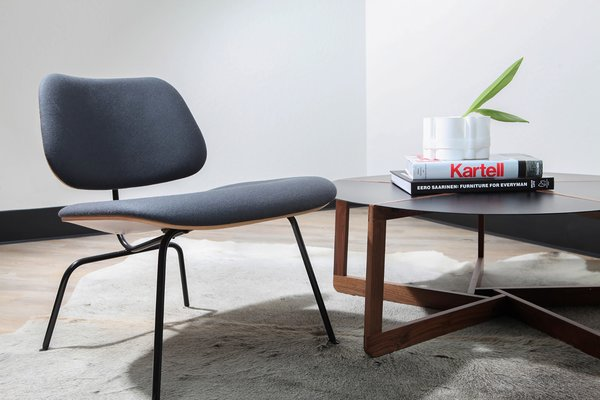 The circular Pi coffee table by Blu Dot and a classic, padded Eames Lounge chair are the perfect combination.
