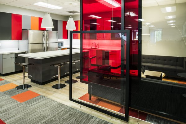 Custom-made panels provide some privacy and separation in the open space.