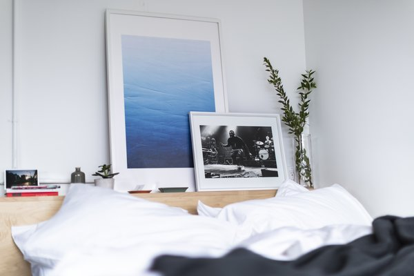 Artwork by local Canadian artists adorns the built-in bed.