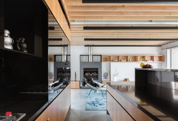 Continuously Run Wood Slats Visually Connect The Open Living Spaces While Adding A Warm Textural