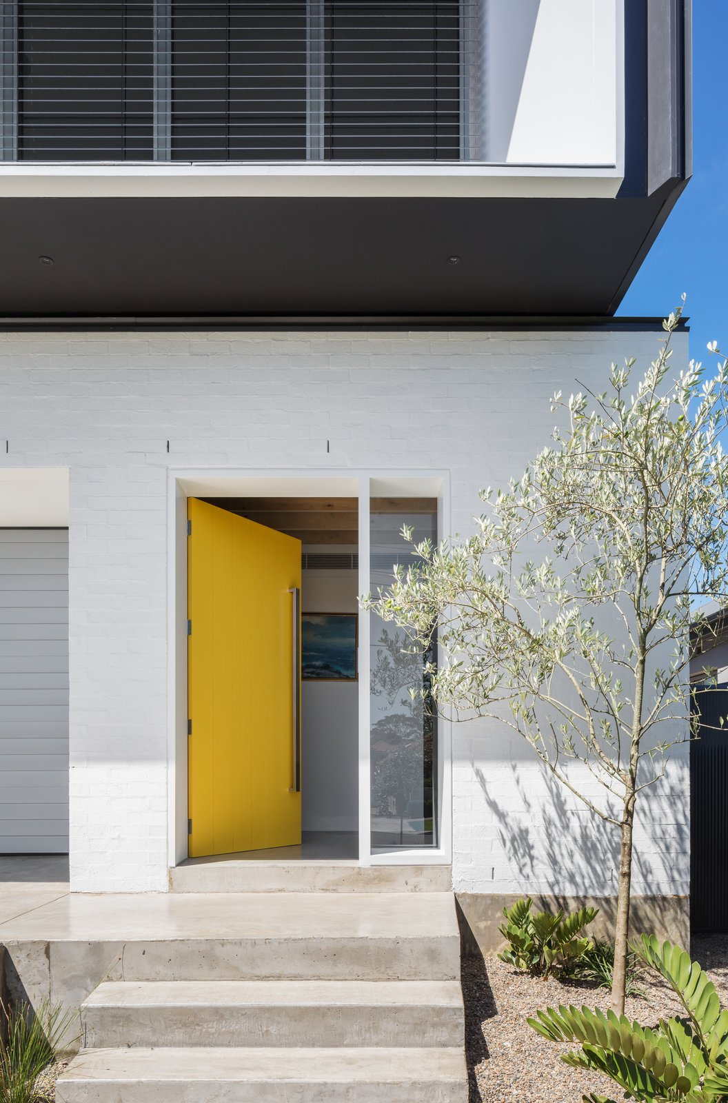 Matraville House entryway with yellow door