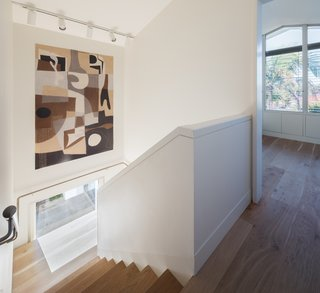 The home features a series of interconnected living spaces, both indoors and outdoors.  An interior stairway leads to the additional bedrooms, shared bath, second living room, and study on the upper floor.