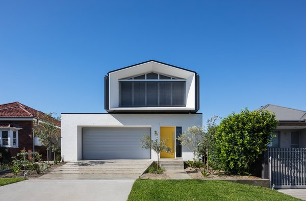 This contemporary dwelling breaks away from the typical vernacular of the neighborhood.  Although boldy modern in aesthetic, it is restrained enough to respect the neighboring homes.