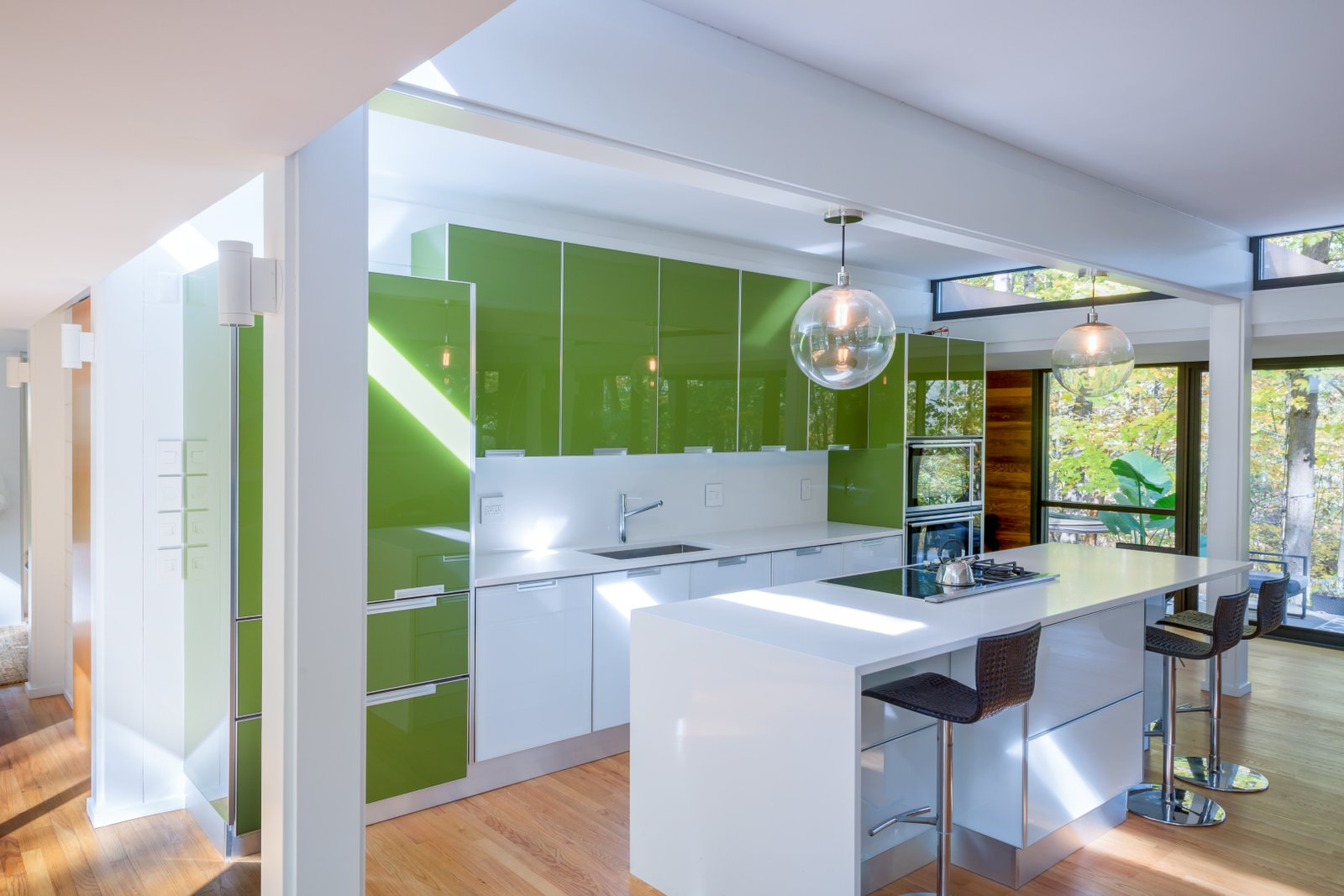 Treehaus kitchen with white and green cabinetry