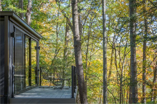 Off the master bedroom, a private deck looks out to the forest.