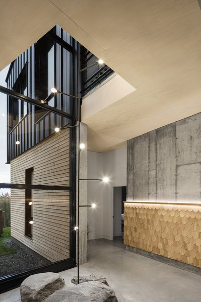 The two-story, light-filled courtyard opens the ground floor up to the floors above, providing visually transparency between floors.