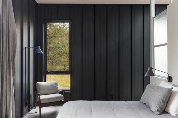 The corrugated metal walls carry inside at special moments, such as in the master bedroom.