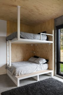 Built-in bunk beds embody the playfulness of camping.