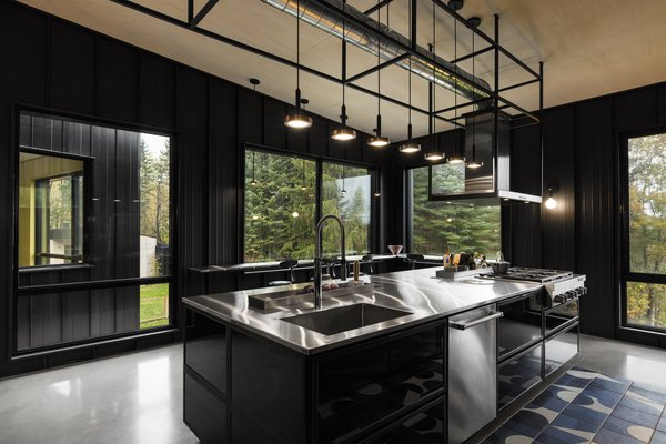 This industrial-style kitchen with stainless steel counter tops is a chef's dream.