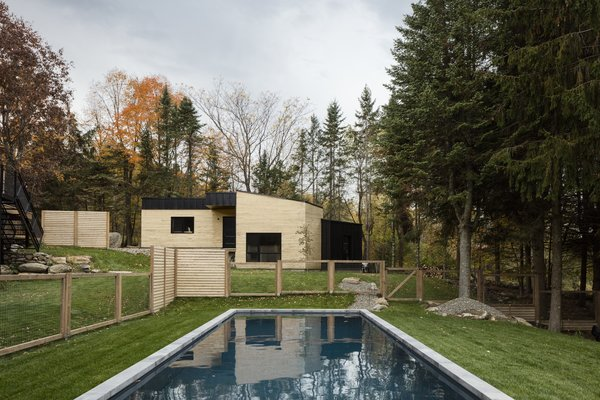 The backyard features an in-ground pool and a garage/workshop.