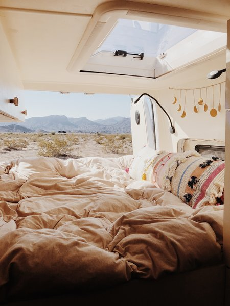 Sleeping in the bedroom feels like camping in the great outdoors. The van's comfort, warmth, and protection provide a first-rate glamping experience.