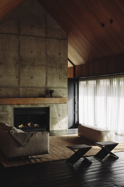 Wood ceilings lend a warm touch to the interiors. A large wood-burning fireplace and cozy lounge furnishings provide the ideal place to relax and soak in the surrounding elements.