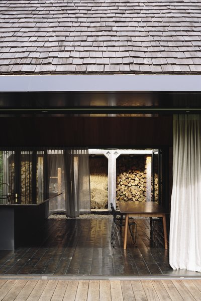 The home's layered facade allows the indoor living spaces to be open or closed to the outdoors.
