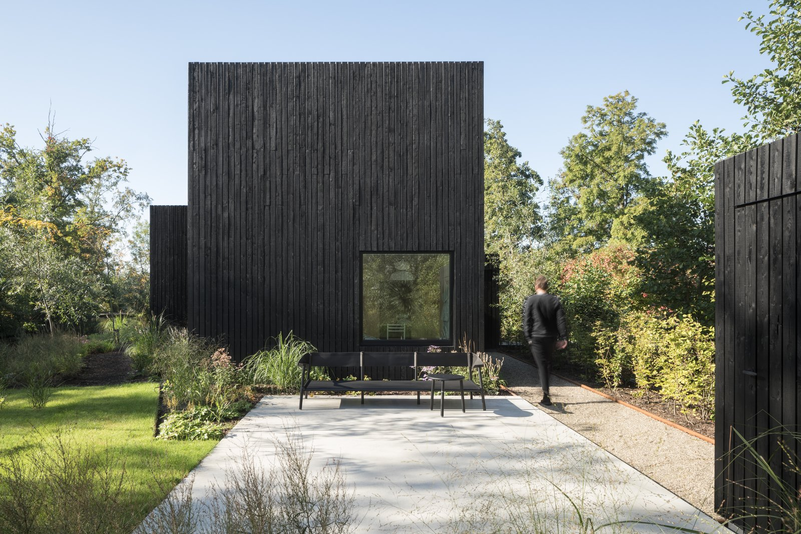 tiny holiday home dark exterior cladding