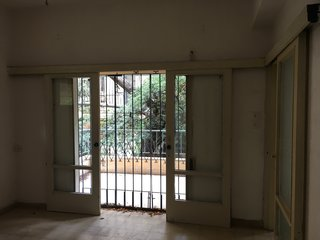 The original opening to the balcony broke up the continuity between indoor and outdoor living spaces.