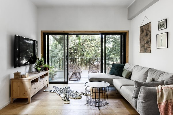 By increasing the width of the sliding glass doors, Broza immensely improved the apartment's visual and physical connection to the outdoors.