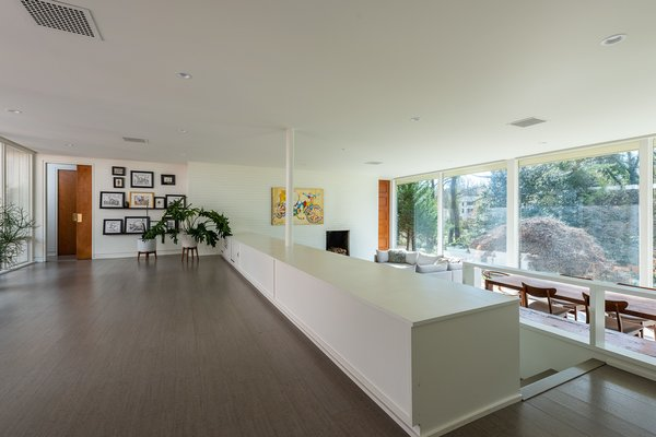 The open, split-level plan allows for continuous flow from space to space, and uninterrupted views from the inside out. The original radiant heating system remains, and cool gray cork floors provide comfort and warmth.