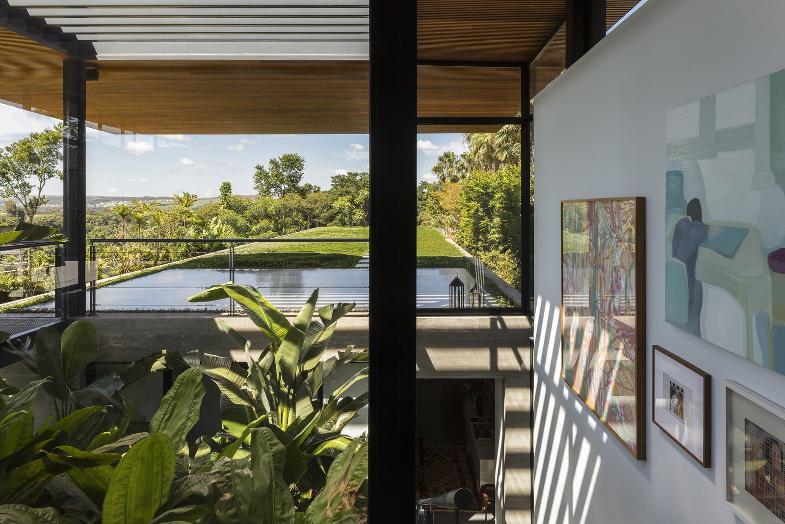 Staircase Picturesque views of the surrounding countryside are eminent at every corner of this home. Large openings fully embrace the surroundings.   Photo 10 of 12 in A Green Roof Helps Camouflage This Striking Home in Brazil