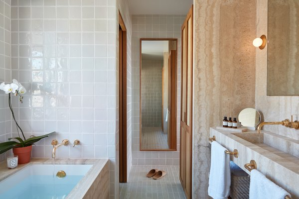 Spa-like bathrooms are the ideal place for a little R&R.