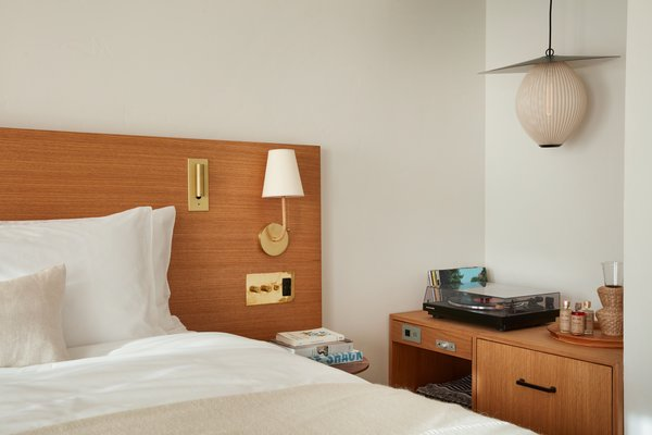 Instead of televisions, rooms are outfitted with vinyl record players and a curated music collection.