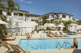 Guests can gather by the pool, which overlooks the ocean. Drink and food service is available.