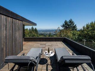 The upper deck, surrounded by a glass rail, is an ideal spot to enjoy panoramic Portland views.