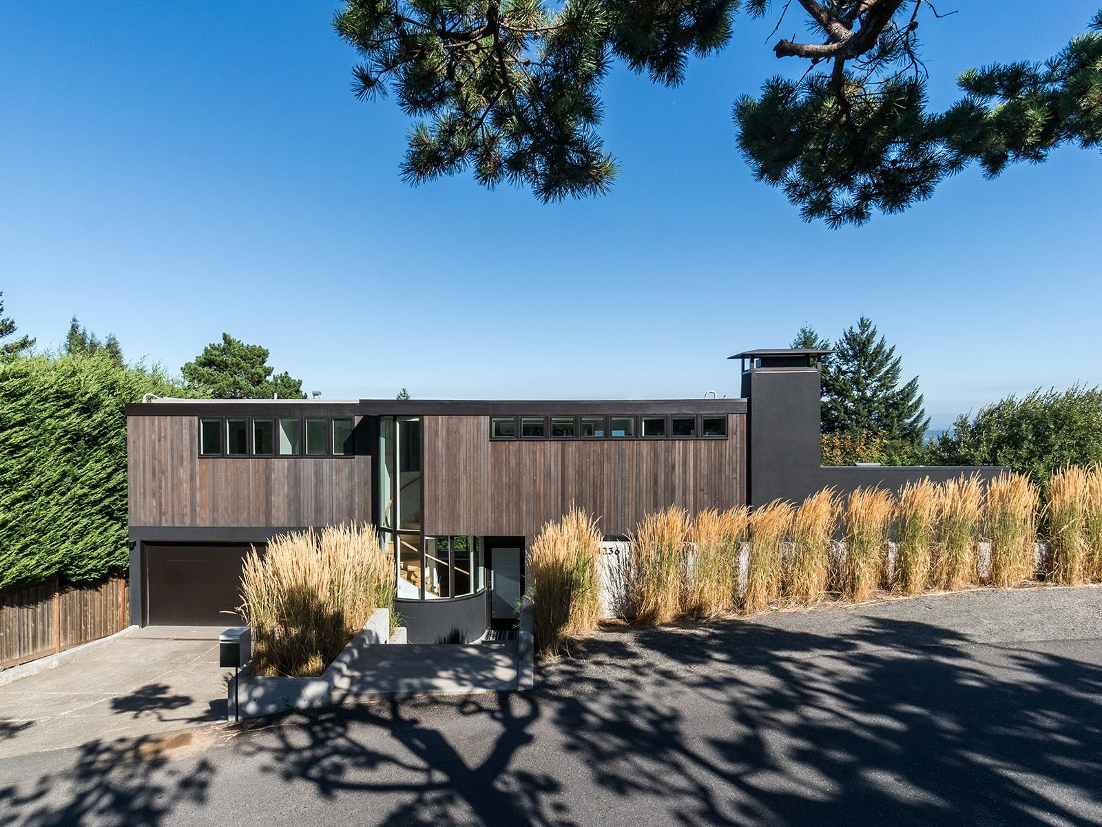 Exterior, Flat, Wood, House, Metal, and Metal Set on a gently slope hillside, the home lies parallel with the landscape, ideally situated to take advantage of panoramic views and solar gains.   Best Exterior Metal Wood House Photos from An Iconic Portland Home With Sweeping Mountain Views Asks $1.75M