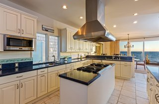 Ocean views can be enjoyed while cooking or entertaining from this chef's kitchen.