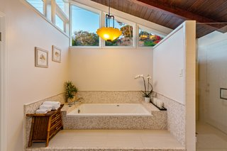 The spa-like master bath has been recently updated.   Clerestory windows draw natural light into the space, while still providing privacy.