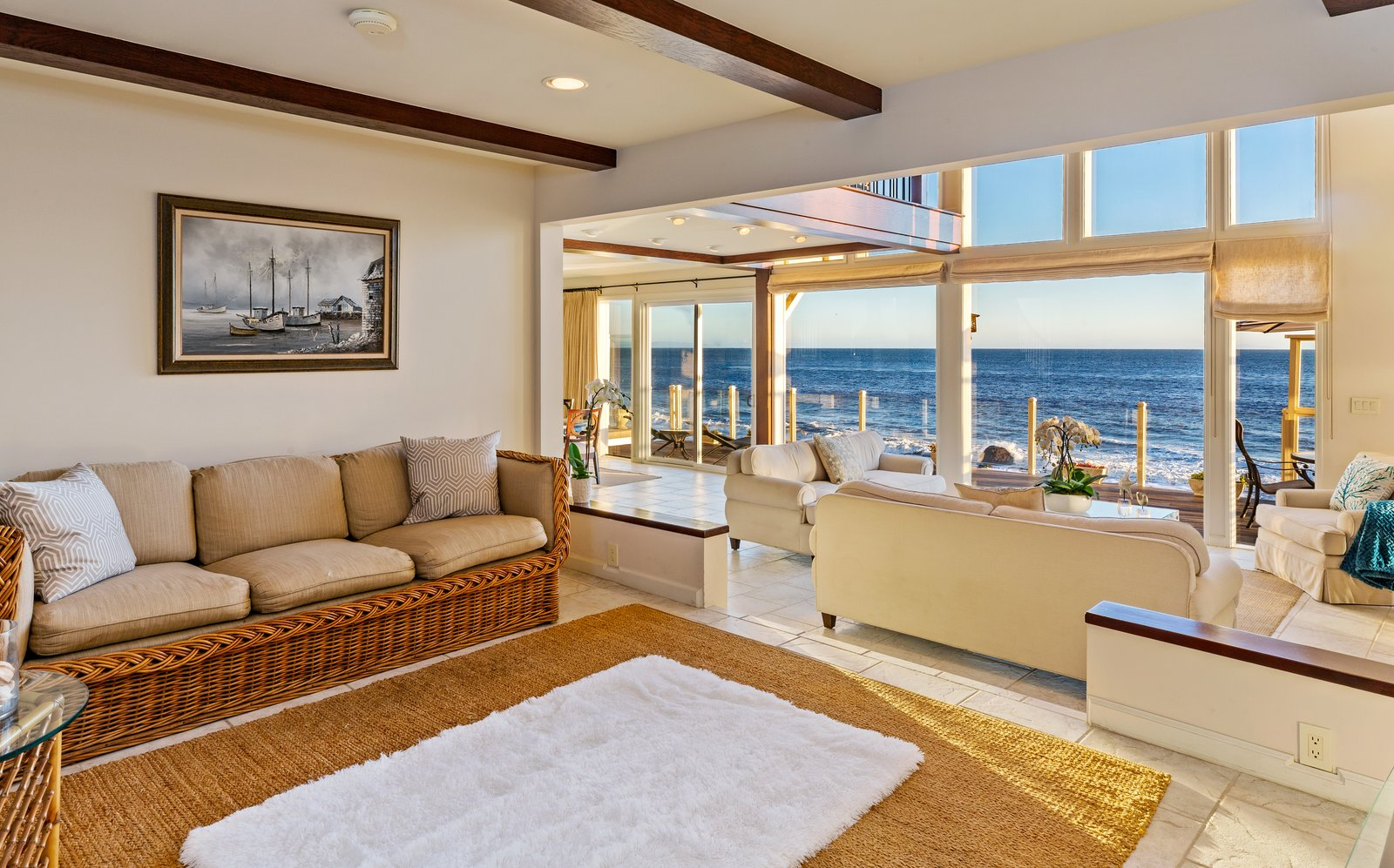 Living Room, Sofa, Chair, Rug Floor, Recessed Lighting, Limestone Floor, Coffee Tables, Ceiling Lighting, and End Tables An open floor plan provides continuous living spaces with uninterrupted ocean views.  Photo 5 of 12 in 'Brady Bunch' Actor Barry Williams Lists His Malibu Home For $6.4M