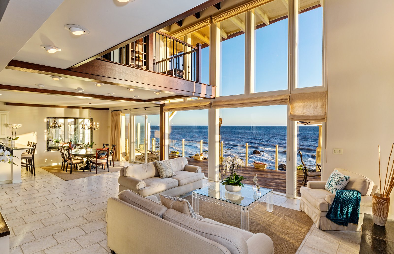 Living Room, Table, Ceiling Lighting, Sofa, Chair, Coffee Tables, Limestone Floor, Recessed Lighting, and Rug Floor The grand, two-story living space is filled with natural light.  Photo 6 of 12 in 'Brady Bunch' Actor Barry Williams Lists His Malibu Home For $6.4M