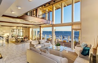 The grand, two-story living space is filled with natural light.