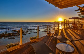 The oceanfront deck provides an idyllic spot for enjoying the ocean waves and watching the sunset.