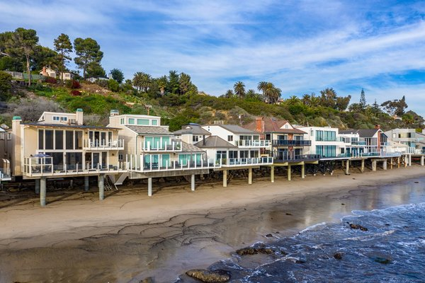 Located in a coveted, beachfront, gated community, this Malibu home is surrounded by ocean views and miles of walking trails.