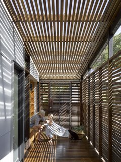 Timber-clad verandas blur the boundaries between indoor and outdoor spaces, while providing  protection and filtered light.