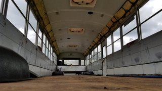 Before: The original interior was industrial and bare, lacking warmth or any touch of home.  Windows extended the whole length of both sides of the bus, as well as the rear.