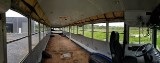 Before: The interior of the original bus minus the traditional rows of bus seats. It was a wide open space to be transformed into a new home on wheels.