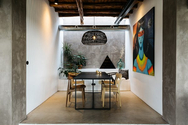 The Dining Space Includes A Built In Bench For Additional Seating Colorful Artwork From