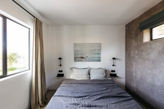 Each of the two bedrooms, simply decorated, have muted color palettes and calming textiles with modern accents.