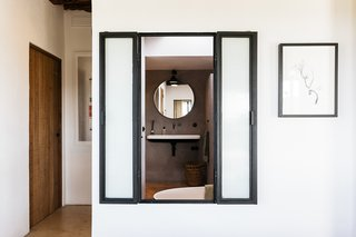 The bathroom includes operable windows, which provide a fireplace and outdoor view while bathing.
