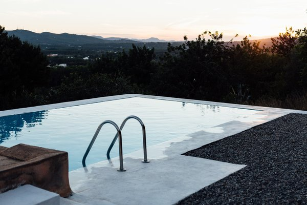 The small swimming pool is a serene place to enjoy sunset views.